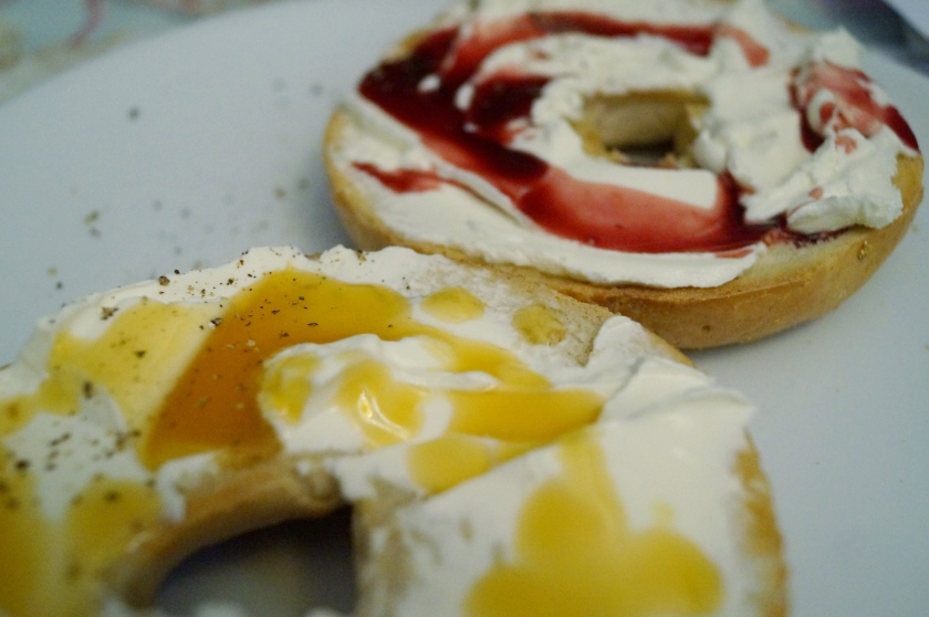 Toasted bagel with cream cheese and either pineapple or pomegranate syrup