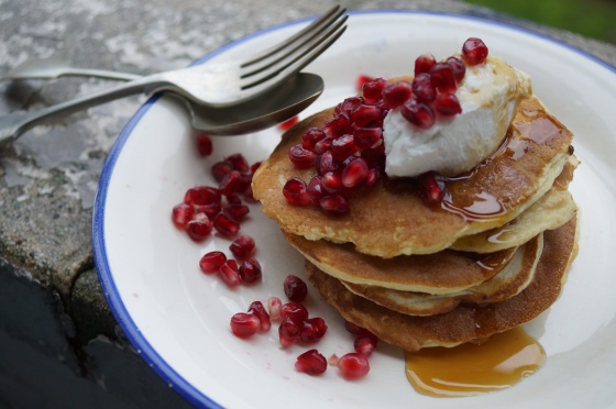 whey pancakes with syrup, cheese and pomegranate